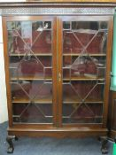 EDWARDIAN DISPLAY CABINET with twin astragal glazed doors on ball and claw feet, 186cms H, 132cms W,