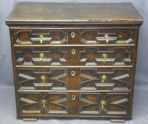 VICTORIAN JACOBETHAN CHEST of four long pine lined drawers, various patterned panels to the front,