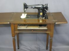 SEWING TABLE WITH SINGER CONTENTS and compartmented drop front, 79cms H, 35cms W, 45cms D (closed)