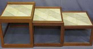 MID-CENTURY TEAK NEST OF THREE TILE TOP TABLES