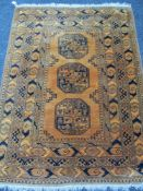 A MUSTARD COLOURED WOOLLEN RUG with tasselled ends, 200 x 143cms