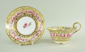A NANTGARW PORCELAIN BREAKFAST CUP & SAUCER having flared shallow body and inverted heart shaped