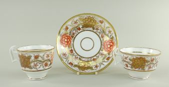 A SWANSEA PORCELAIN JAPAN PATTERN TRIO the two cups with curvaceous ogee handles, decorated with a