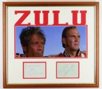 STANLEY BAKER & IVOR EMMANUEL AUTOGRAPHS in pen and on separate sheets, framed with a Zulu