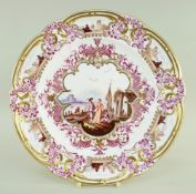 A FINE & VERY RARE NANTGARW PORCELAIN PLATE IN THE MEISSEN STYLE lavishly decorated in puce