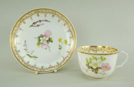 A SWANSEA PORCELAIN CUP & SAUCER the cup with ear-shaped loop handle, locally decorated with flowers