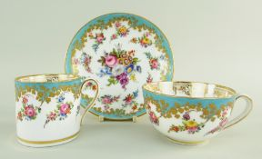 A NANTGARW PORCELAIN TRIO comprising breakfast cup, coffee can and saucer, decorated in the early-