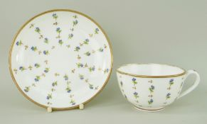 A NANTGARW PORCELAIN CUP & SAUCER decorated with scattered cornflower motifs within a solid gilt