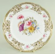 A SMALL NANTGARW PORCELAIN PLATE of lobed circular form, the border moulded with c-scrolls,