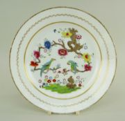 A SWANSEA PORCELAIN PLATE WITH 'PARAKEETS IN A TREE' PATTERN with both birds chained to a gnarled