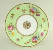 A SWANSEA PORCELAIN PLATE WITH LIME GREEN RESERVE BORDER painted with sprays of flowers and