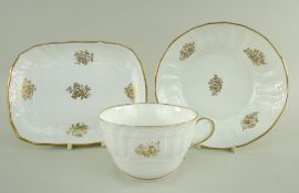 A SWANSEA PORCELAIN PART TEA SERVICE WITH BASKET WEAVE MOULDING comprising breakfast cup with