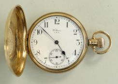 9CT GOLD WALTHAM FULL HUNTER POCKET WATCH having engine turned outer case, revealing enamel face