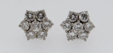 PAIR OF WHITE METAL SEVEN-STONE DIAMOND CLUSTER EARRINGS, each stone 0.07ct approximately (visual