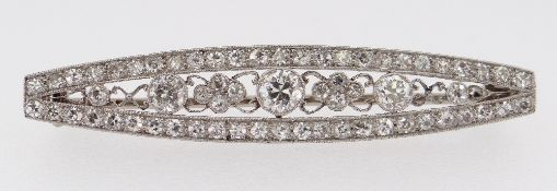 WHITE METAL ART DECO DIAMOND BAR BROOCH, the tapering boat shaped design encrusted with diamonds,