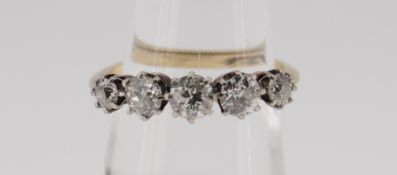 18CT GOLD FIVE STONE DIAMOND RING the five claw set stones totalling 0.75cts approximately (visual