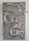 CHINESE SILVER CARD CASE, makers mark 'NM' c. 1900, embossed in high relief with a four-clawed