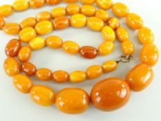 STRING OF AMBER BUTTERSCOTCH BEADS the oval graduated beads measuring 1.3cms long (smallest) to 3cms