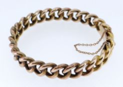 15CT GOLD FIXED CURB LINK BRACELET WITH SAFETY CHAIN, 25.6gms, stamped '15' to the clasp, 6.75cms