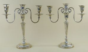PAIR GEORGE V SILVER THREE-LIGHT CANDELABRA, Thomas Bradbury and Sons, London 1917, with reeded drip