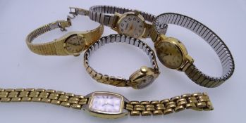 FIVE LADY'S WRISTWATCHES - a yellow metal circular dial wristwatch no. 432247 with incorporated bark