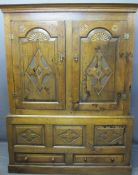 CIRCA 1800 CARVED OAK PRESS CUPBOARD with fan detail and Gothic type crosses on shaped and chamfered