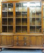 EARLY 20TH CENTURY MAHOGANY BOOKCASE, the closed top inverted cornice over three eight pane glazed