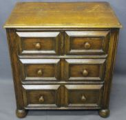 NEAT CONTINENTAL OAK CHEST of two short over two long drawers with reeded front detail on bun