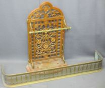 VICTORIAN CAST IRON STICK STAND and a brass fender, the stand with pierced floral detail, brass