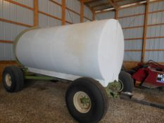 2000 gal steel tank on heavy Parker gear w/pump & hose, 16.5-16.1 tires.
