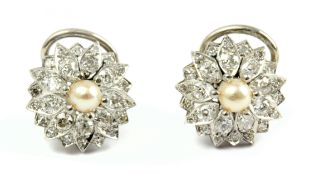 A pair of pearl and diamond cluster earrings