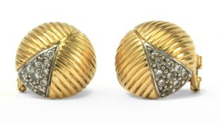 Puig Doria. A pair of diamond and 18k. gold stud earrings