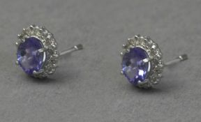 A pair of diamond and kyanite cluster earrings