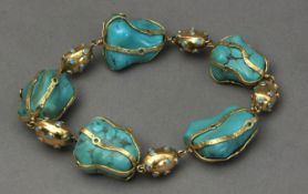 A rough turquoise beads and 18k. yellow gold bracelet