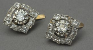A pair of first half of 20th century diamond earrings