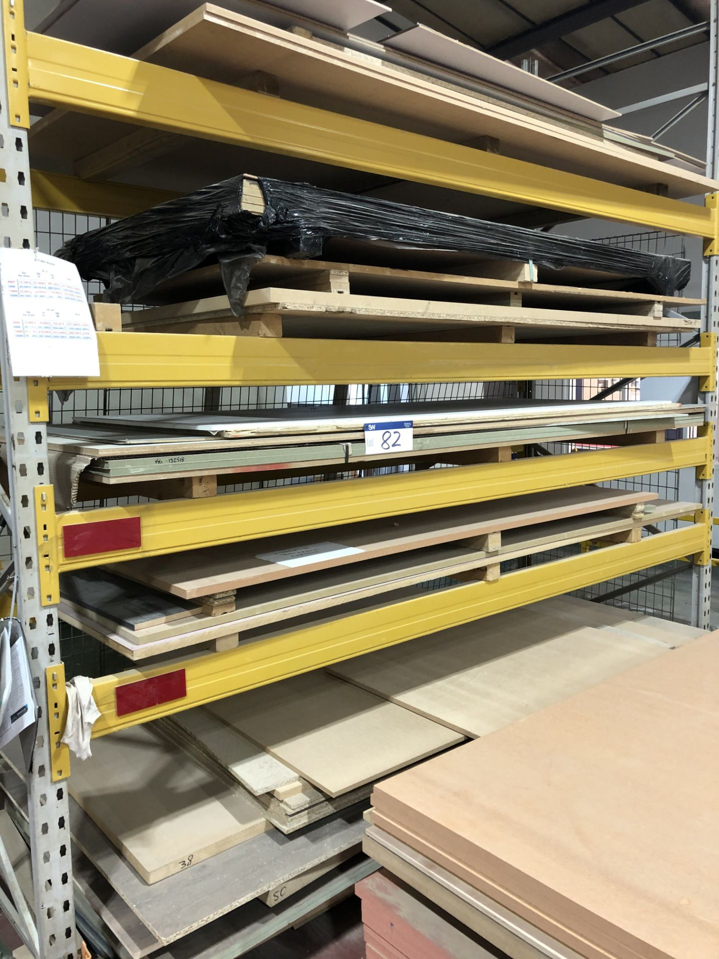 Lot 82 - Contents to this Rack Including Various Sheets of MDF, Chipboard etc