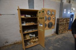 Double Door Wood Cabinet, with contents including