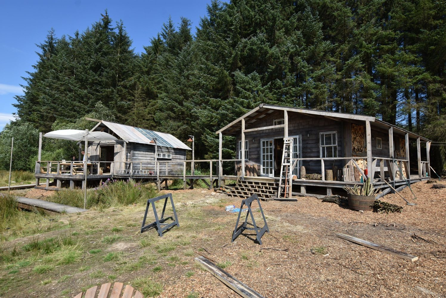 Short Notice Auction - Two Timber Buildings/ Cabins, Shower & Toilet Cubicles and Connecting Walkways (erected new August 2020)