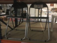 Two Vinyl Upholstered Folding Chairs