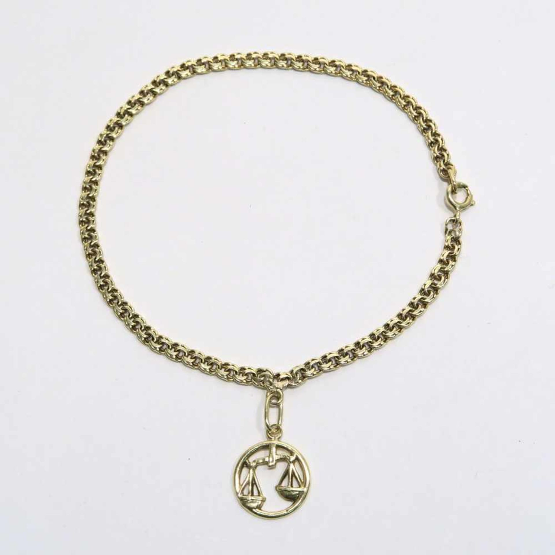 """Los 54 - Armband14 K GG, (geprüft). Garibaldi-Armband mit Sternzeichen-Anhänger """"Waage"""". L. 19 cm. 4,2"""