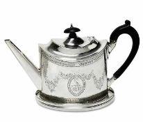 Teekanne und Untersetzer