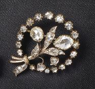 Ausdrucksstarke DiamantbroscheE. 19. Jh.In Form eines Blumenstraußes mit umgebendem Reif,