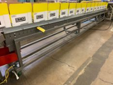 (Located in Burlington WI) Gravity Flow Conveyor for Cases. RIGGING FEE: $1900