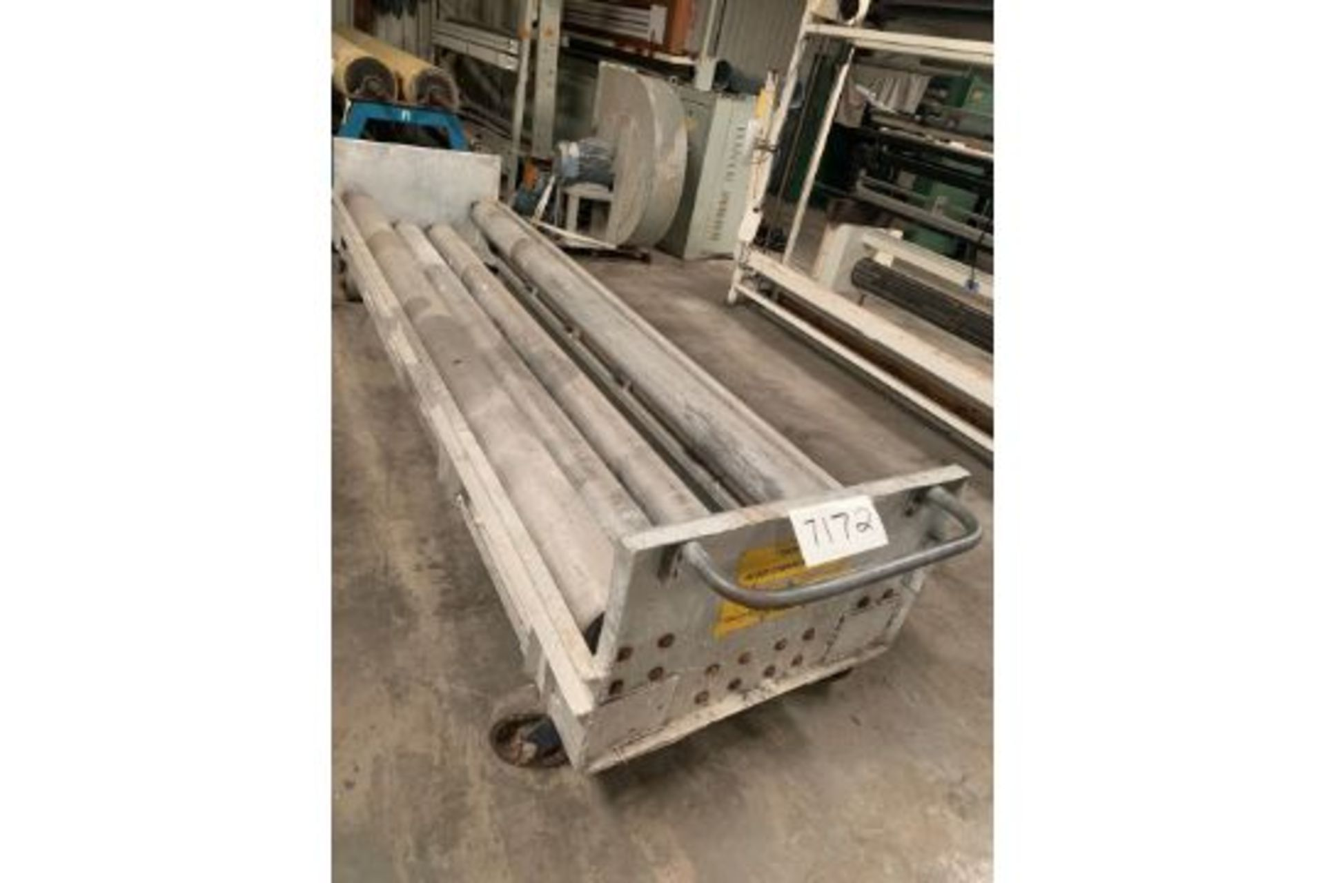 Lot 21122 - Four roll textile unwind cradle with idler rolls 130'' inches long, can handle roll diameters of 12""