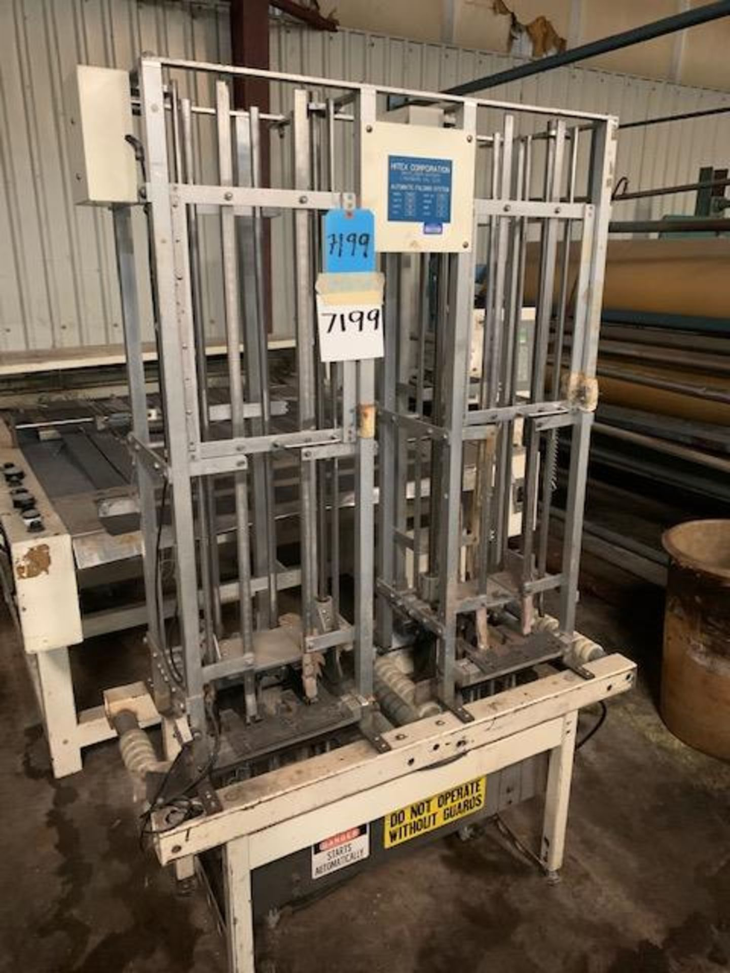 Lot 21135 - Hiltex Automatic Folding System. Model 45122. Serial 1032. Volts 220 60HZ, Rigging Fee: $100