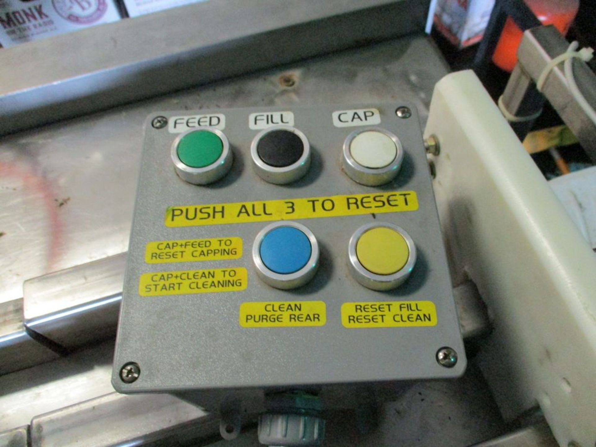Semi-automatic 6 station bottle filler with spare parts, 112 in x 74 in ***Auctioneer Note*** -- $ - Image 6 of 14