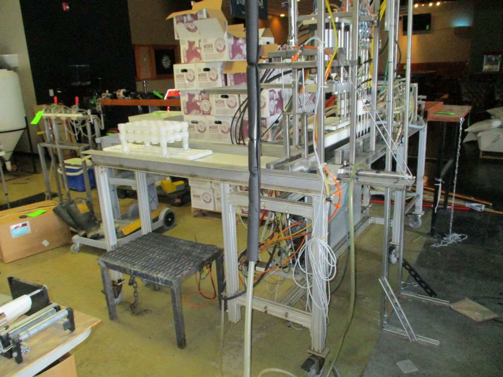 Semi-automatic 6 station bottle filler with spare parts, 112 in x 74 in ***Auctioneer Note*** -- $ - Image 2 of 14