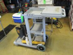 Plastic push cart with workstation and rubber boots ***Auctioneer Note*** -- $25 Removal & Loading