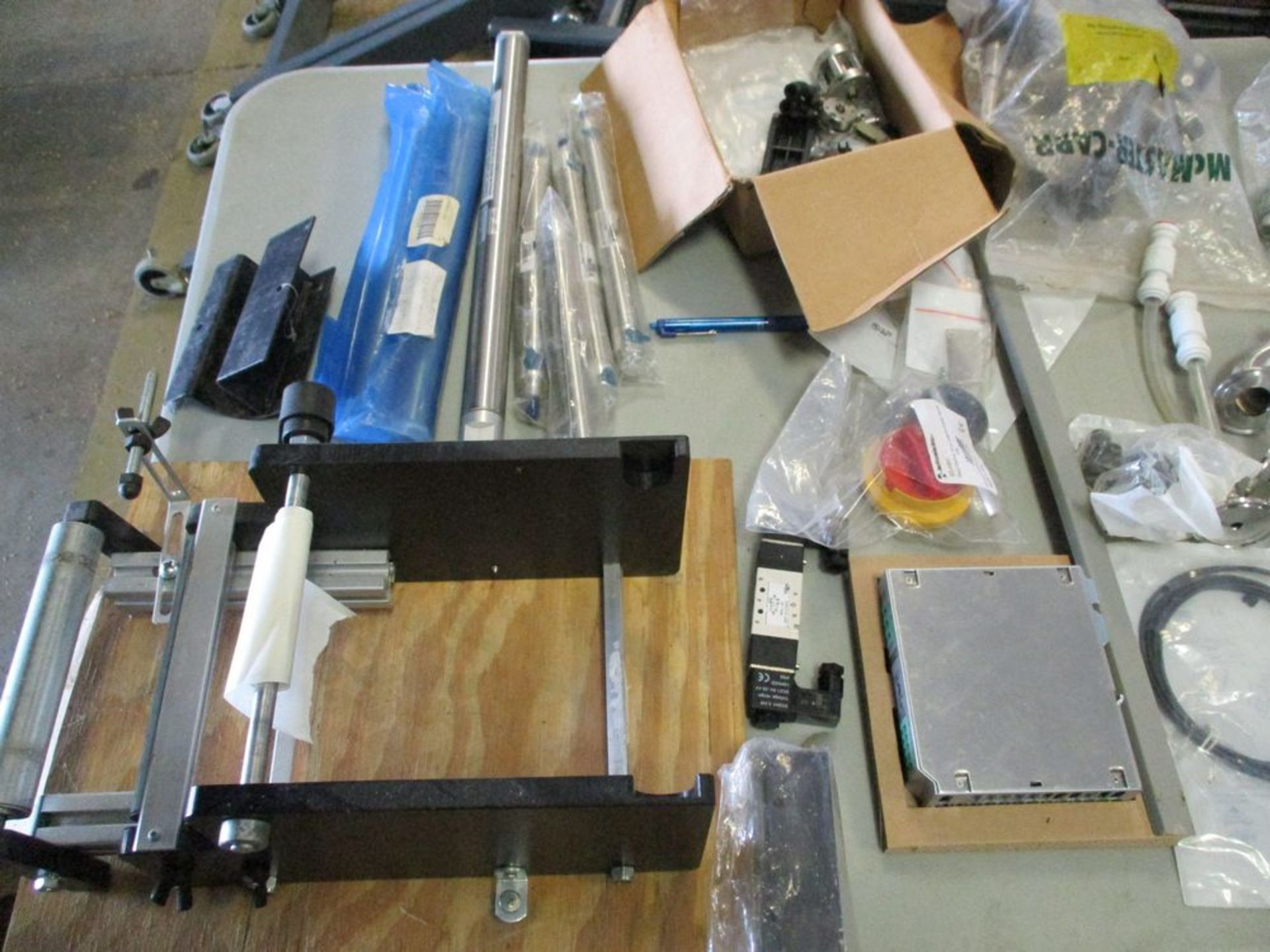 Semi-automatic 6 station bottle filler with spare parts, 112 in x 74 in ***Auctioneer Note*** -- $ - Image 7 of 14