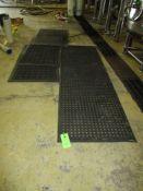 LOT OF 4 rubber mats, 1- 106 in x 32 w , 2- 62 in x 32 in w , 1- 55 in x 32 in w ***Auctioneer